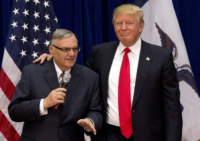 FILE - In this Jan. 26, 2016 file photo, then-Republican presidential candidate Donald Trump is joined by Joe Arpaio, the sheriff of metro Phoenix, at a campaign event in Marshalltown, Iowa.