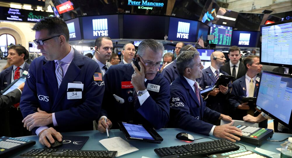 Traders work on the floor of the New York Stock Exchange (NYSE) in New York, U.S., July 19, 2017