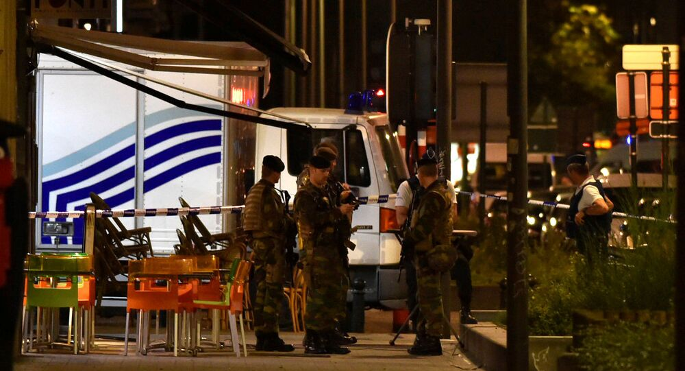 Policemen and Belgian soldiers react on the scene after Belgian soldiers shot a man who attacked them with a knife, in Brussels, Belgium August 25, 2017