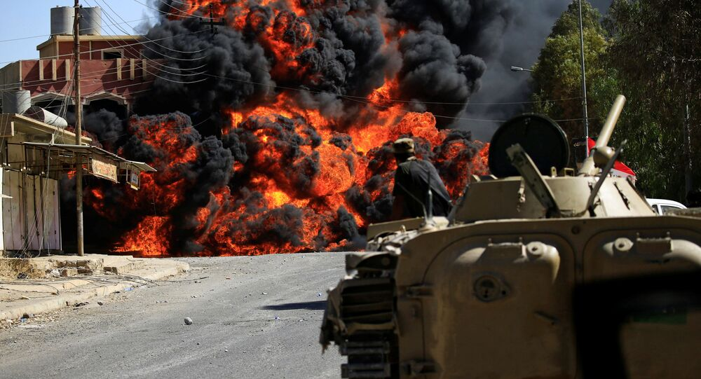 Smoke rises during clashes between joint troop of Iraqi army and Shi'ite Popular Mobilization Forces (PMF) against the Islamic State militants in Tal Afar, Iraq August 26, 2017