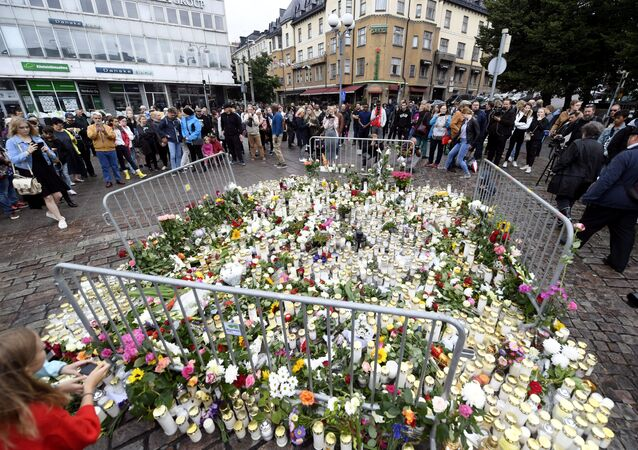 Memorial candles and flowers are placed to commemorate the victims of Friday's stabbings at the Turku Market Square, in Turku, Finland August 19, 2017