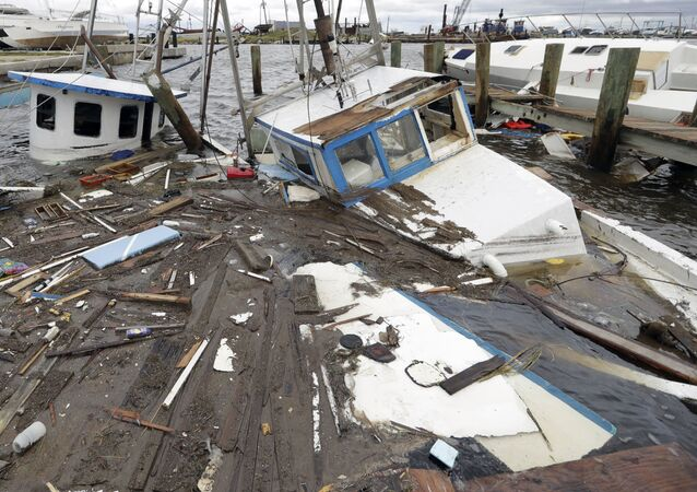 Boats that sunk in the wake of Hurricane Harvey are surrounded by floating debris Sunday, Aug. 27, 2017, in Rockport, Texas.