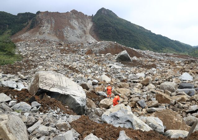 Rescue workers search for survivors at the site of a landslide that occurred in Nayong county, Guizhou province, China August 28, 2017.