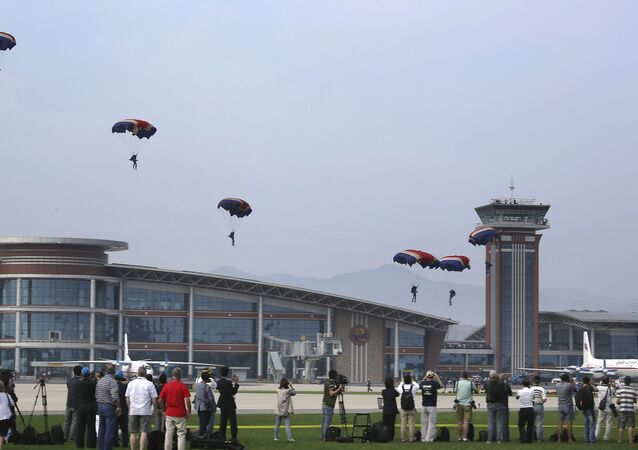 Military parachutists descend upon Kalma Airport on Sunday, Sept. 25, 2016, in Wonsan, North Korea.