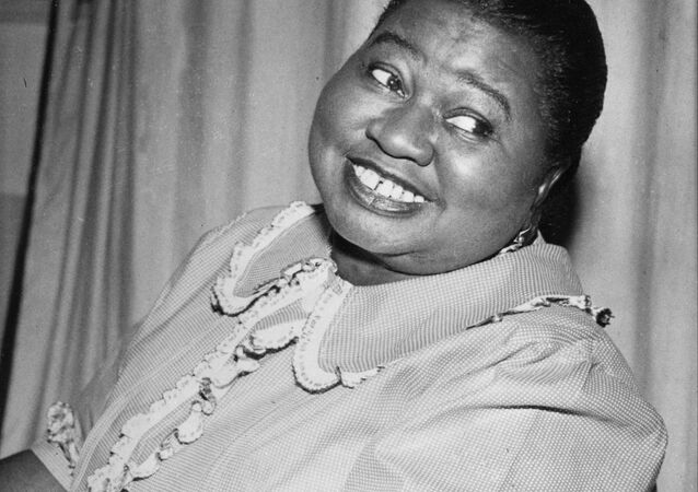 Hattie McDaniel plays a tune as she portrays the title role of Beulah in the CBS Radio Network's comedy series in New York City, Aug. 1951.