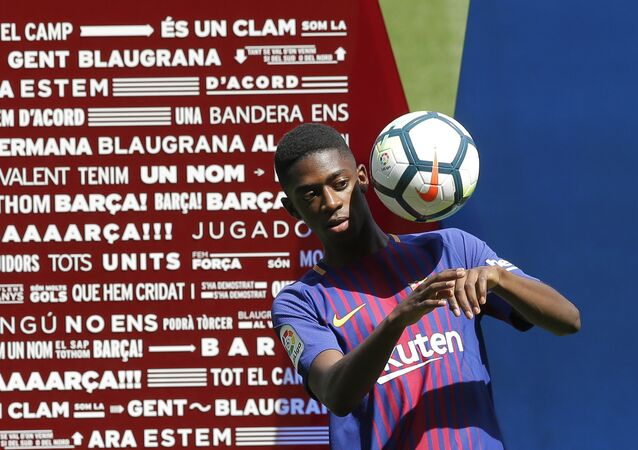 French soccer player Ousmane Dembele controls the ball during an official presentation at the Camp Nou stadium in Barcelona, Spain