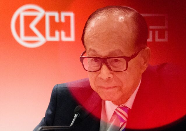 Hong Kong's richest man Li Ka-shing, 88, listens to a question during a press conference in Hong Kong on March 22, 2017, after his flagship CK Hutchison Holdings posted a net profit of 4.25 billion USD for 2016, six percent up year-on-year.