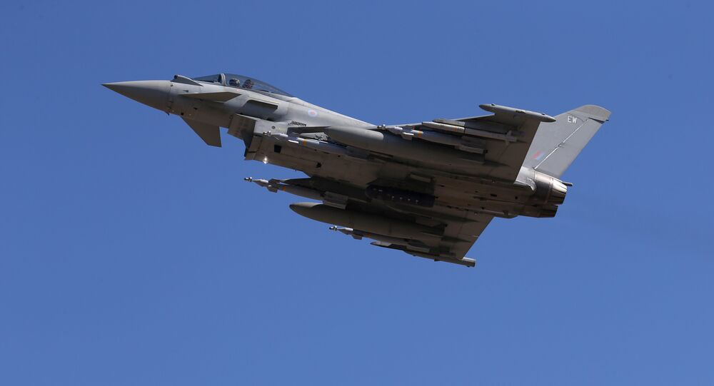 In this Thursday, Sept. 22, 2016, a Typhoon aircraft takes off from RAF, Akrotiri, Cyprus. British air forces for a mission in Iraq. British Tornado and Typhoon aircraft stationed at a U.K. air base in Cyprus are pounding Islamic State targets
