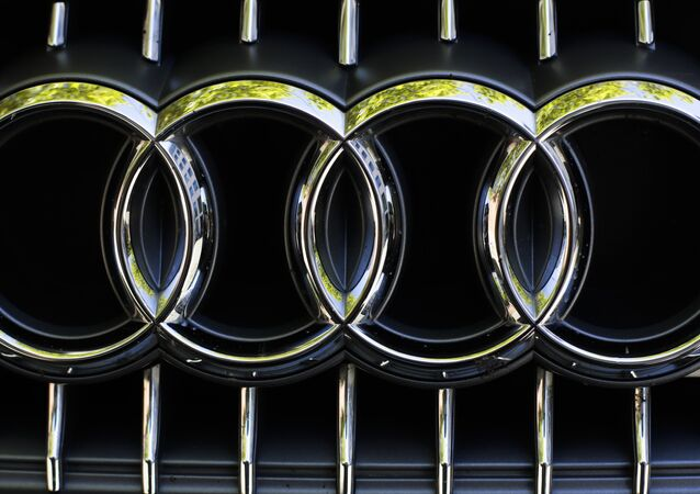 The sign of German car company Audi photographed at the front of a car in Berlin, Germany.