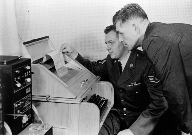 This Aug.30, 1963 black-and-white file photo shows the White House Kremlin hot line providing direct communication for emergency use by the Chief of Staff in Washington and Moscow, becaming operational. Air Force Sgt. John Bretoski, left, and Army Lt. Col. Charles Fitzgerald, man the equipment in the Pentagon during a test run. The Pentagon is the U.S. operating terminal for both the land line-transocean circuit and the alternate radio circuit, with a direct relay to the White House.