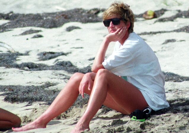 Princess Diana relaxes on the sand during a visit to the beach on the Caribbean Island of Nevis January 4, 1993.
