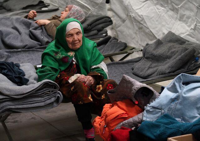 105-year old Afghan woman. Bibihal Uzbeki from Kunduz, Afghanistan, rests in Croatia's main refugee camp at Opatovac, Croatia, near the border with Serbia, Tuesday, Oct. 27, 2015