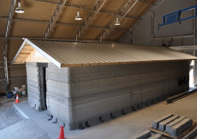 A barracks hut constructed with the Automated Construction of Expeditionary Structures is a new construction technology that prints concrete structures