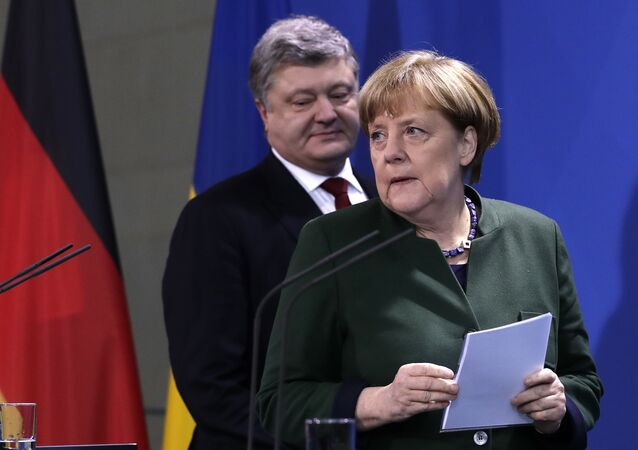 Ukrainian President Petro Poroshenko, left, and German Chancellor Angela Merkel arrive for statements prior to a meeting in Berlin, Germany, Monday, Jan. 30, 2017