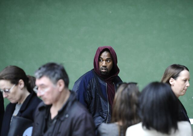 U.S singer Kanye West arrives at Celine's ready-to-wear Fall-winter 2015/2016 collection during the Paris Fashion Week in Paris, France, Sunday, March 8, 2015.