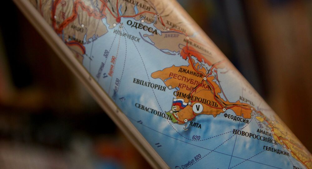 A rolled-up political map of Europe. Such maps showing Crimea as part of the Russian Federation are now on sale in Simferopol