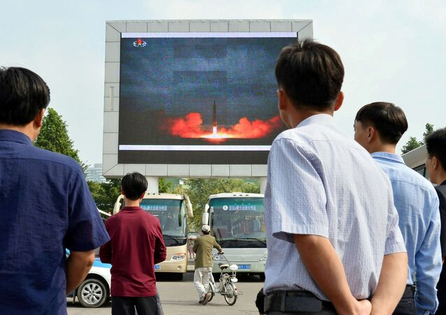 North Koreans watch a news report showing North Korea's Hwasong-12 intermediate-range ballistic missile launch on electronic screen at Pyongyang station in Pyongyang, North Korea, in this photo taken by Kyodo August 30, 2017