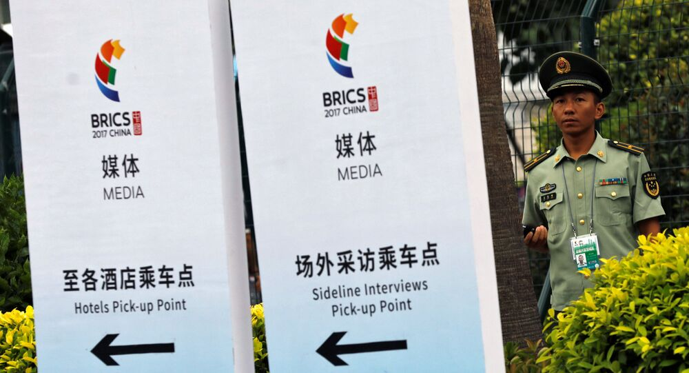 A paramilitary police officer stands outside the media center of BRICS (Brazil, Russia, India, China and South Africa) Summit in Xiamen, China September 2, 2017