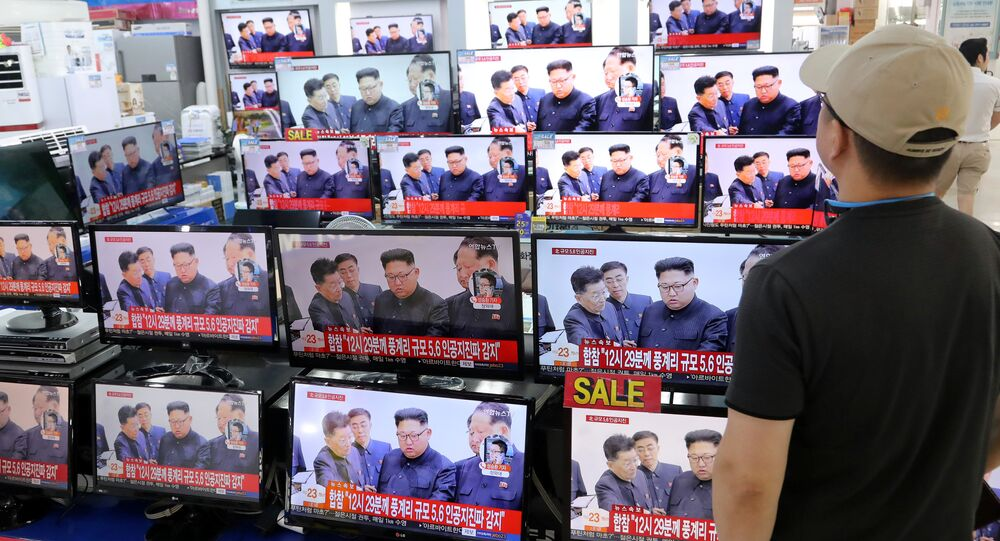 A man watches TV news report about North Korea's nuclear test at an electronic shop in Seoul, South Korea on September 3, 2017