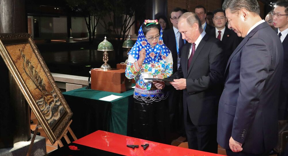 September 3, 2017. Russian President Vladimir Putin and Chinese President Xi Jinping at the exhibition of the Chinese cultural heritage in Xiamen