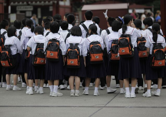 A group of students gather to listen to their teachers at a temple in Tokyo (File)