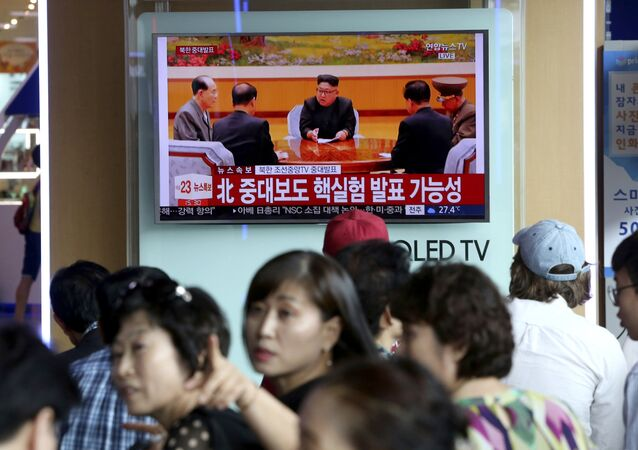 People watch a TV news program showing North Korean leader Kim Jong Un at the Seoul Railway Station in Seoul, Sunday, Sept. 3, 2017.