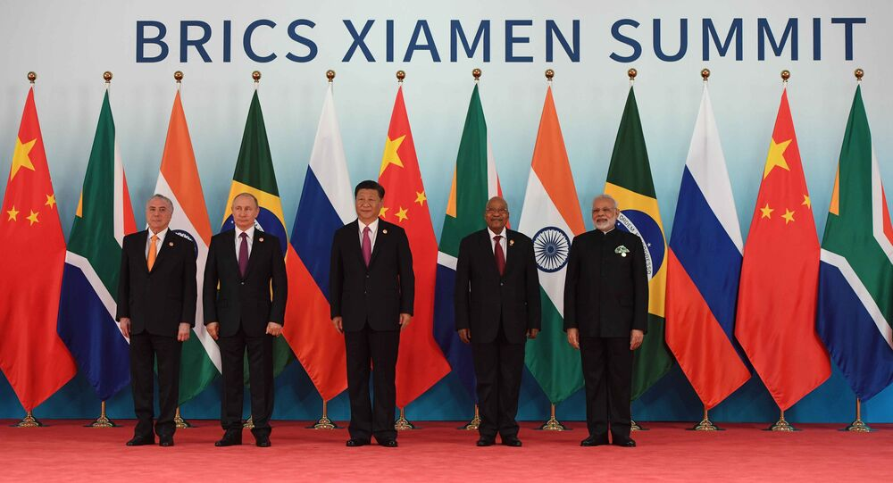 September 4, 2017. Russian President Vladimir Putin poses for a group photograph of the BRICS leaders. From right: Indian Prime Minister Narendra Modi, South African President Jacob Zuma and Chinese President Xi Jinping. Left: Brazilian President Michel Temer