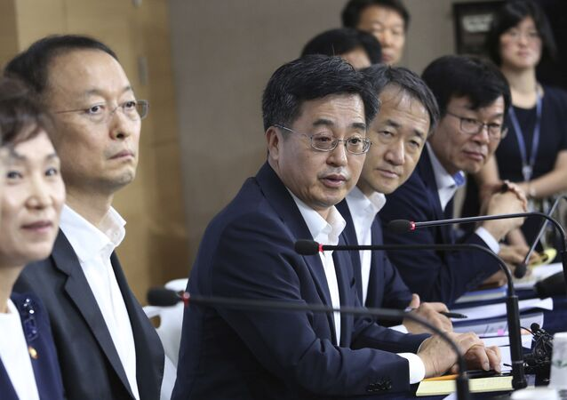 South Korean Finance Minister Kim Dong-yeon, center, speaks during a press conference at the government complex in Seoul, South Korea