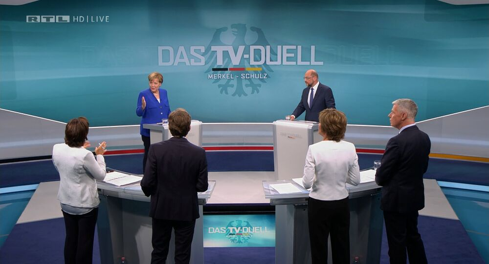 A screen that shows the TV debate between German Chancellor Angela Merkel of the Christian Democratic Union (CDU) and her challenger Germany's Social Democratic Party SPD candidate for chancellor Martin Schulz in Berlin, Germany, September 3, 2017.