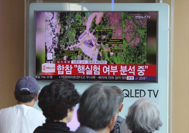 People watch a TV news reporting about a possible nuclear test conducted by North Korea ,at the Seoul Railway station in Seoul, South Korea, Sunday, Sept. 3, 2017