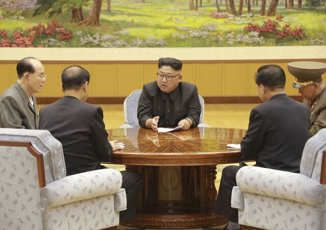In this Sept. 3, 2017, image distributed on Monday, Sept. 4, 2017, by the North Korean government, North Korea's leader Kim Jong Un holds a meeting of the ruling party's presidium