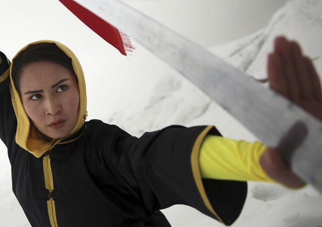 Shaolin martial arts trainer, Sima Azimi, 20, performs on a hilltop in Kabul, Afghanistan