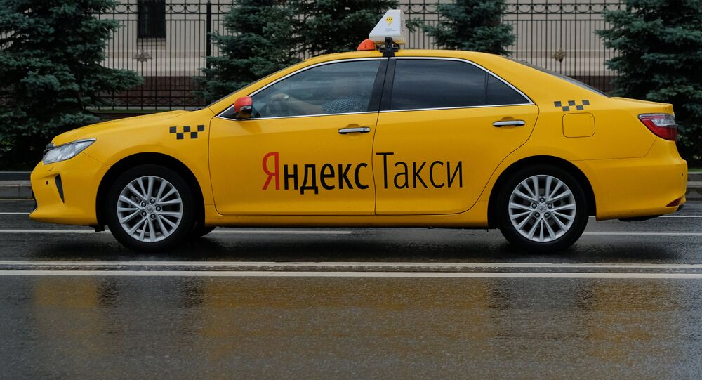 A car of the Yandex Taxi service in a street of Moscow