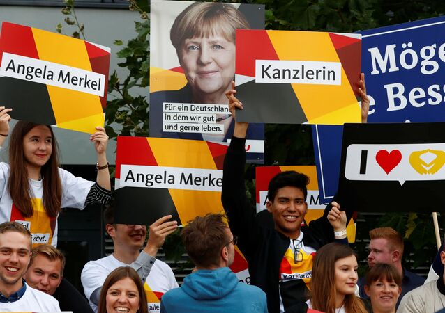 Supporters of German Chancellor Angela Merkel of the Christian Democratic Union party (CDU) hold banners before a TV debate with her challenger Germany's Social Democratic Party SPD candidate for chancellor Martin Schulz in Berlin, Germany, September 3, 2017.