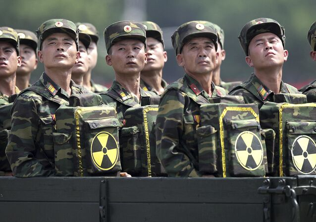 North Korean soldiers turn and look towards their leader Kim Jong Un
