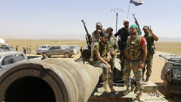 Syrian army fighters stand guard in the Qara area, in Syria's Qalamoun region (File) - Sputnik International