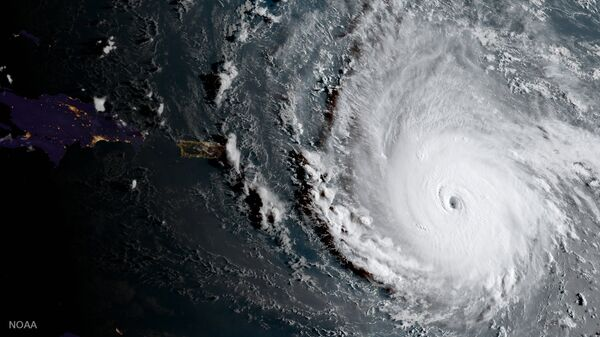 In this geocolor image captured by GOES-16 and released by the National Oceanic and Atmospheric Administration (NOAA), Hurricane Irma, a potentially catastrophic category 5 hurricane, moves westward, Tuesday morning, Sept. 5, 2017, in the Atlantic Ocean toward the Leeward Islands. - Sputnik International