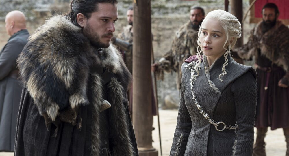 This image released by HBO shows Kit Harington, left, and Emilia Clarke on the season finale of Game of Thrones. The series set yet another audience record Sunday with its seventh-season finale.