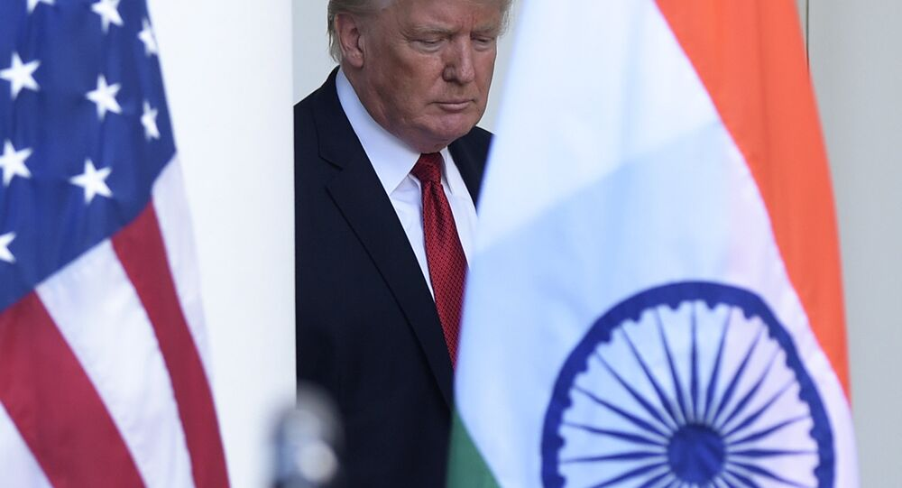 President Donald Trump walks out from the Oval Office to make a joint statement with Indian Prime Minister Narendra Modi in the Rose Garden of the White House in Washington