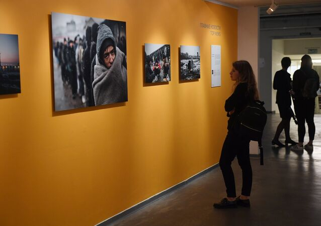 At the exhibition of Andrei Stenin International Press Photo Contest finalists' works at the Lumiere Brothers Center for Photography in Moscow