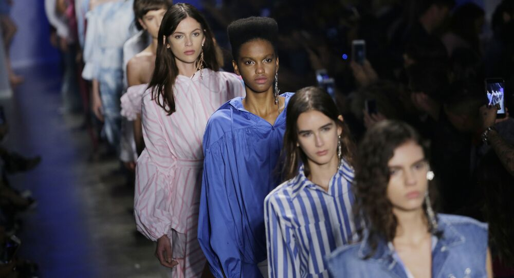 Models wear creations from the Two Denim collection during the Sao Paulo Fashion Week in Sao Paulo, Brazil, Tuesday, Aug. 29, 2017.