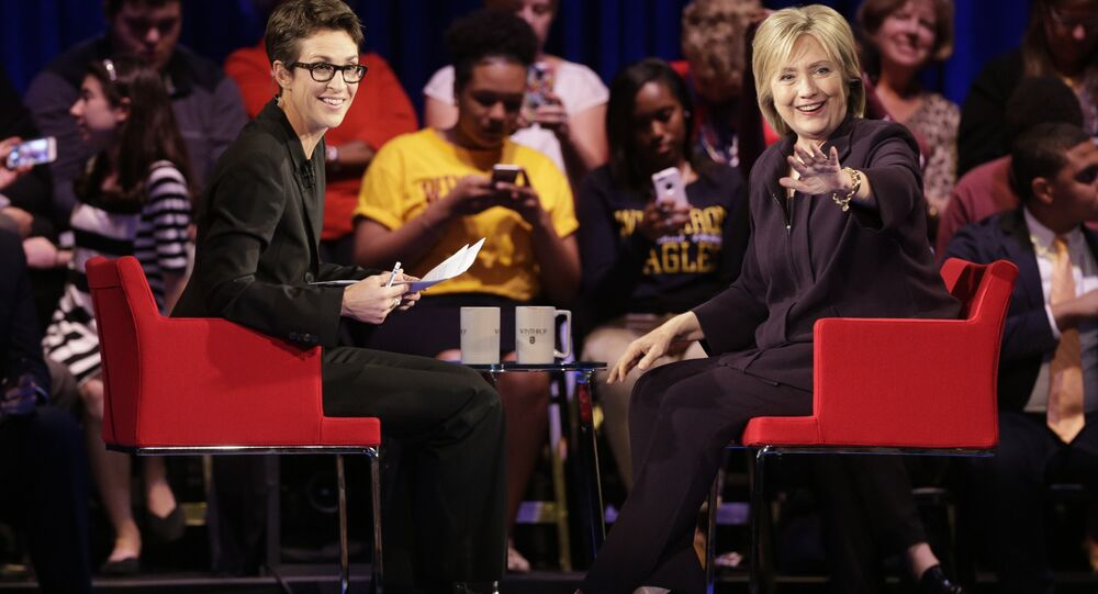 Democratic presidential candidate, Hillary Rodham Clinton, right, waves to the crowd as MSNBC's Rachel Maddow, left, watches during a democratic presidential candidate forum at Winthrop University in Rock Hill, S.C., Friday, Nov. 6, 2015.