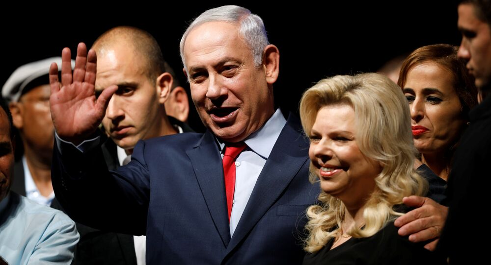 Israeli Prime minister Benjamin Netanyahu (C) and his wife Sara react to his supporters during an event by his Likud Party in Tel Aviv, Israel August 9, 2017