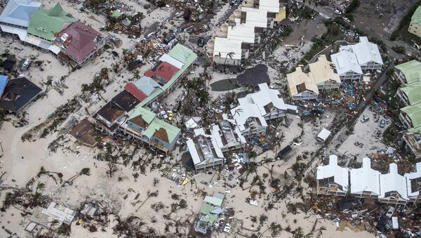 This Sept. 6, 2017 photo provided by the Dutch Defense Ministry shows storm damage in the aftermath of Hurricane Irma, in St. Maarten. Irma cut a path of devastation across the northern Caribbean, leaving thousands homeless after destroying buildings and uprooting trees. - Sputnik International
