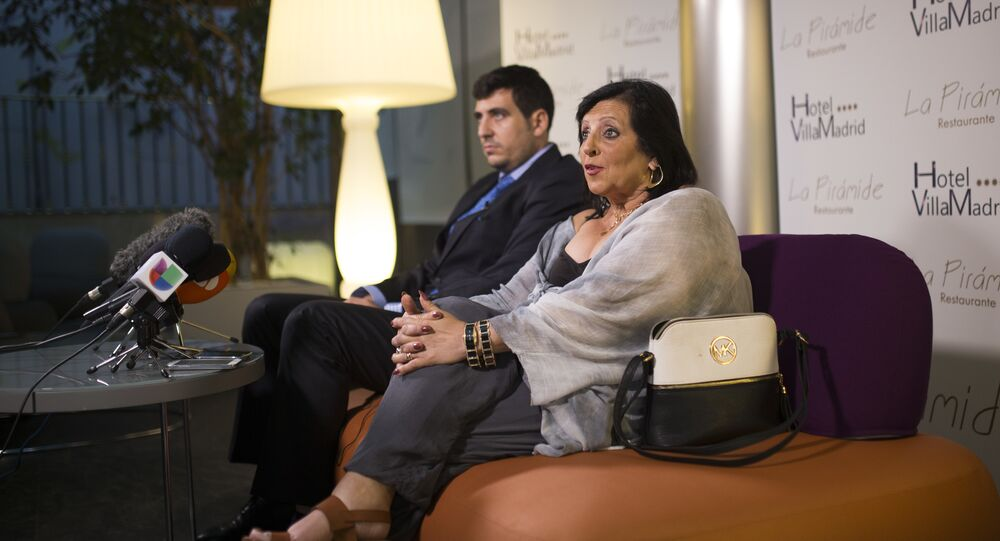 In this photo taken on Wednesday, July 19, 2017, Pilar Abel, right, talks to journalists next to her lawyer Enrique Blanquez during a news conference in Madrid, where she claimed to be the daughter of eccentric artist Salvador Dali