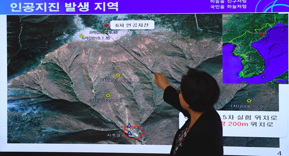 Lee Mi-Seon, a director of the National Earthquake and Volcano Center, shows a map of a North Korean location during a briefing about the artificial earthquake in North Korea, at the Korea Meteorological Administration in Seoul on September 3, 2017