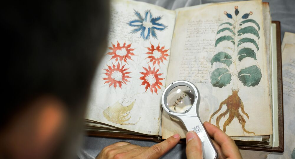 Quality control operator of the Spanish publishing outfit Siloe Luis Miguel works on cloning the illustrated codex hand-written manuscript Voynich in Burgos on August 9, 2016.