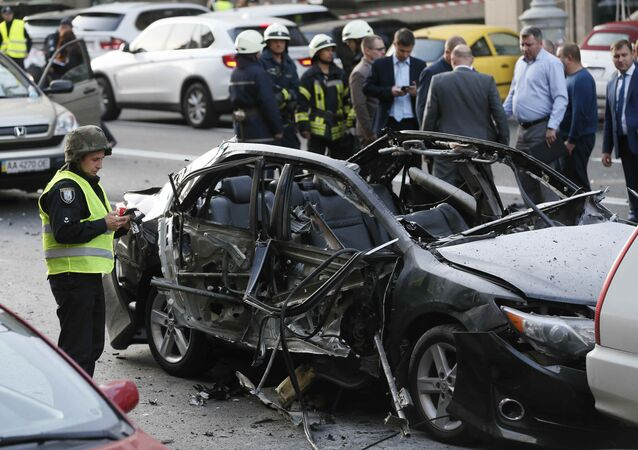 Investigators gather around a car, which was reportedly damaged by an explosion, in Kiev, Ukraine