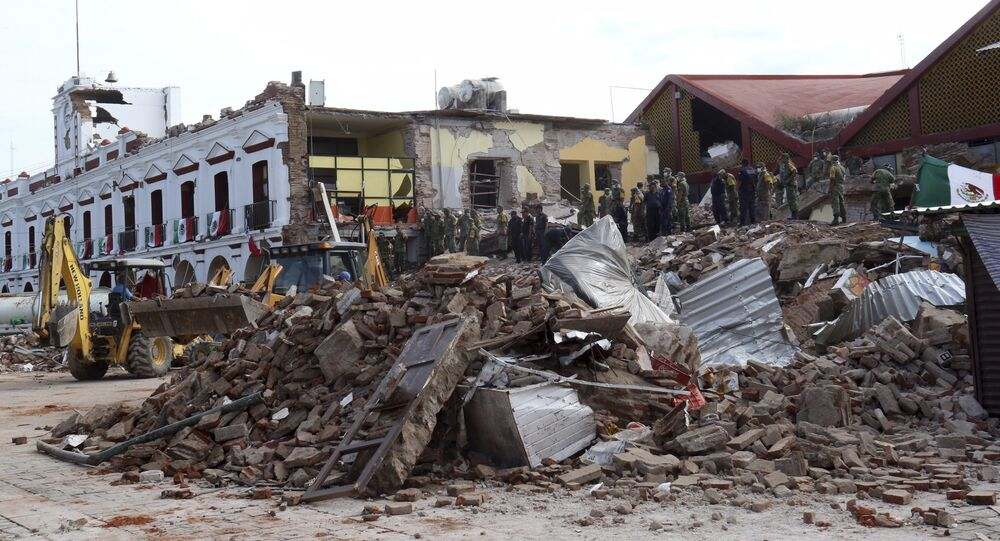 Soldiers remove debris from a partly collapsed municipal building after an earthquake in Juchitan, Oaxaca state, Mexico, Friday, Sept. 8, 2017.