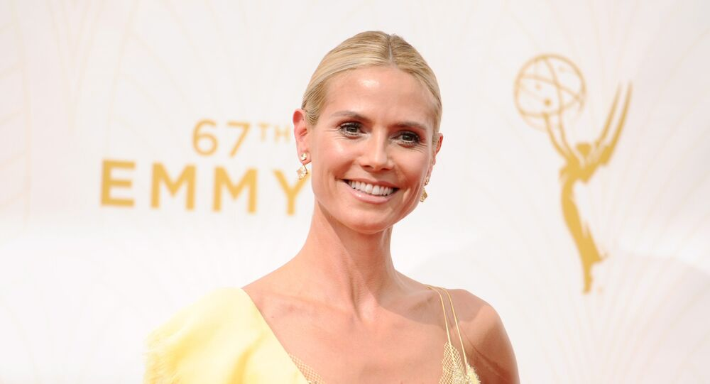 Heidi Klum arrives at the 67th Primetime Emmy Awards on Sunday, Sept. 20, 2015, at the Microsoft Theater in Los Angeles